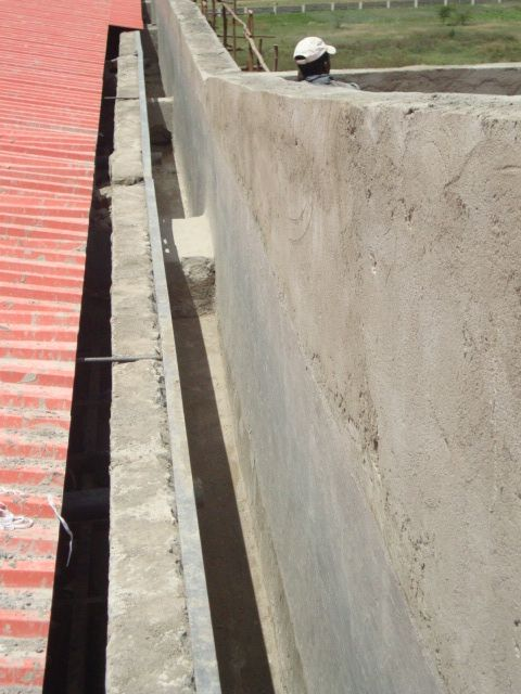 GREY LIQUID FLEXIBLE RUBBER applied to a concrete gutter of a commercial development in Athiriver