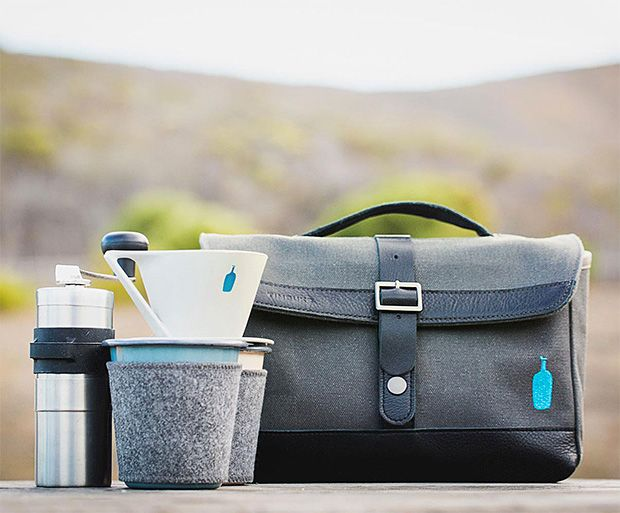 Timbuk2 x Blue Bottle Travel Coffee Kit - The kit includes a stainless steel grinder, dripper, filters, Falcon Enamelware tumblers, a sample bag of Three Africans drip blend and a pair of felt zarfs.