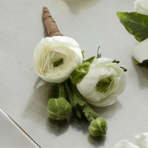 $14/ bout -> 1 groom, 5 groomsmen, 4 dads, 1 grandpa, ( two ring bears?) The FTD® White Ranunculus Boutonniere