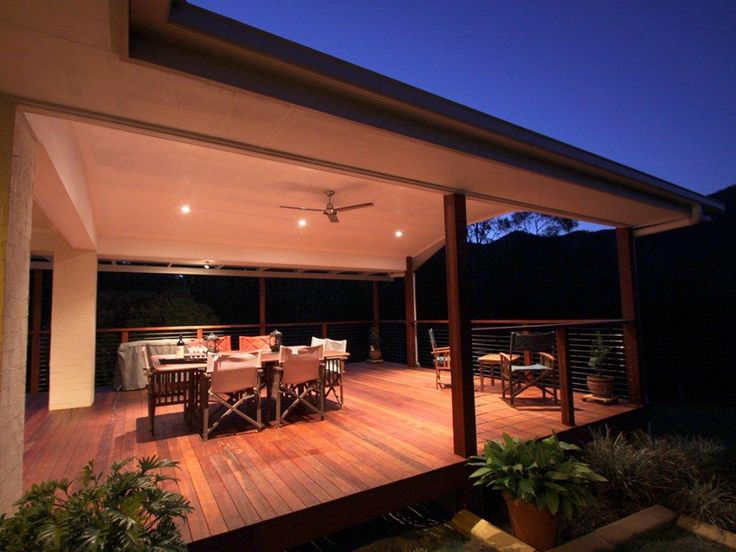 Covered Deck Design | Captivating Covered Outdoor Deck Design With Romantic Warm Lights And ...