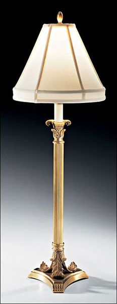 """This lovely lamp is made with antiqued solid brass and features a round piped fabric shade. The lamp takes a single 60 watt max bulb (not included). The lamp measures 10 1/4"""" in diameter X 26 1/2""""H an"""