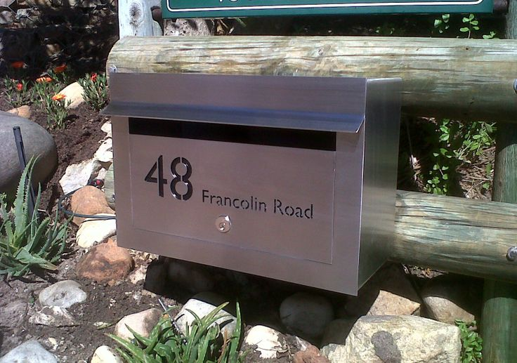 External Landscape Stainless Steel Letterbox with cut-out text in the door panel and backed with black perspex. Grade 316 stainless steel with brushed finish.