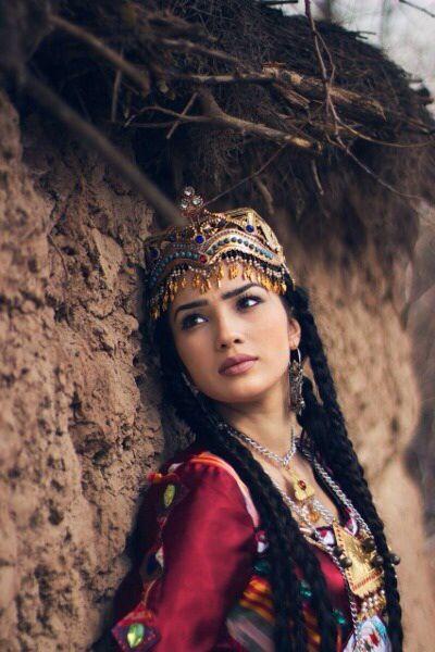 Tajik woman in traditional attire. Tajikistan. Photos by Nani