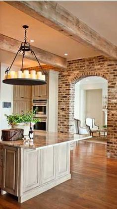 Brick wall, rustic beams and lovely chandeleir.