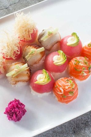 """SUSHI BOMBS AT MOMO SUSHI SHACK  These adorable little guys are technically called """"temari."""" We're partial to the Spicy Mc Bomb, with tuna, cucumber, spicy mayo and katafi."""