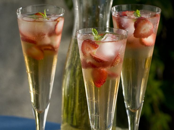Cava Sangria...1 bottle Spanish cava, chilled   1/4 cup white grape juice   2 tablespoons brandy   2 tablespoons simple syrup   Ice cubes, for serving   1/2 cup sliced strawberries   8 mint leaves