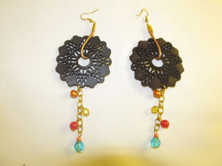 Handmade earrings with brown leather filigree (1 pair)  Made with brow leather filigrees, leather cord, antiallergic hangings, chain, semiprecious stones and glass beads.