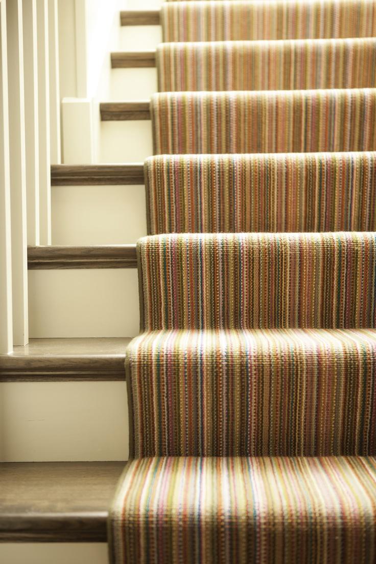 Cute Brightly colored striped stair runner Karen Kempf Interiors Copyright Milwaukee Magazine Adam Ryan
