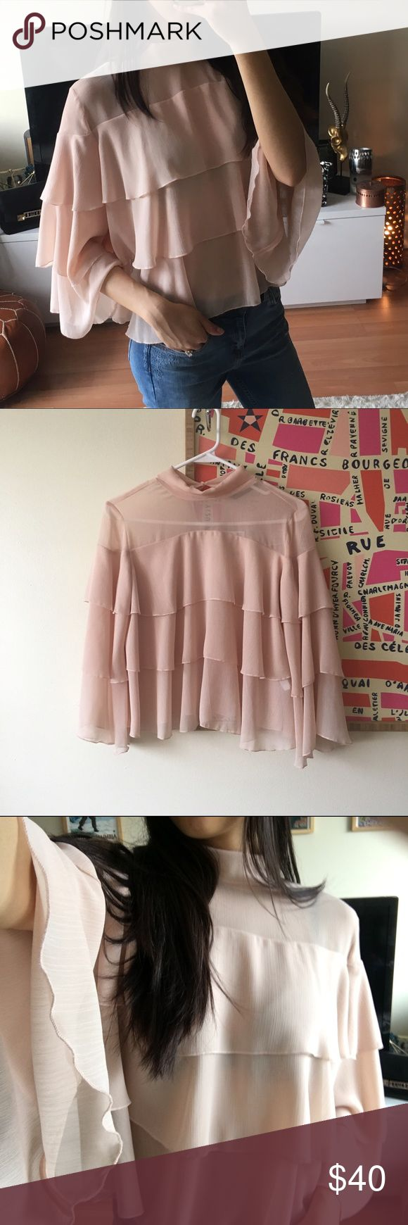 BNWT Zara ruffled tier Top XS Brand new never worn. 100% polyester. Doesn't wrinkle easily. Slightly Sheer at top layer Zara Tops