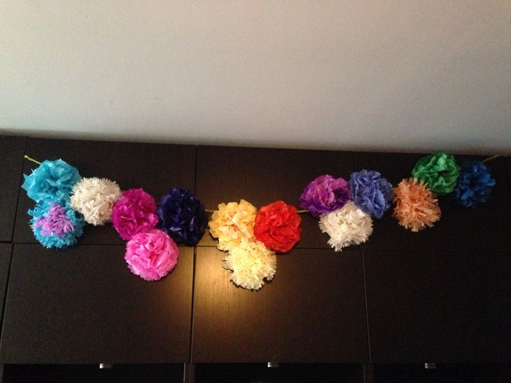 Home-made tissue paper flowers made from tutorials found on Pinterest. Success!!