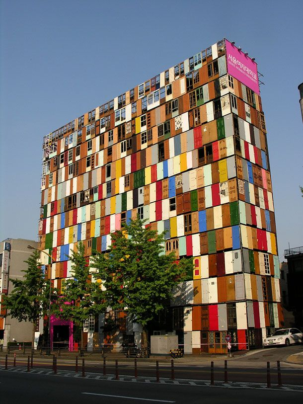 "1,000 Door Building - South Korean artist and designer Choi Jeong-Hwa used 1,000 old doors to create an unusual ten-storey door building in South Korea. This colorful public art installation titled ""Doors"" was built in Soeul back in 2009 and I'm pretty sure it holds the record for the most doors in a single building."