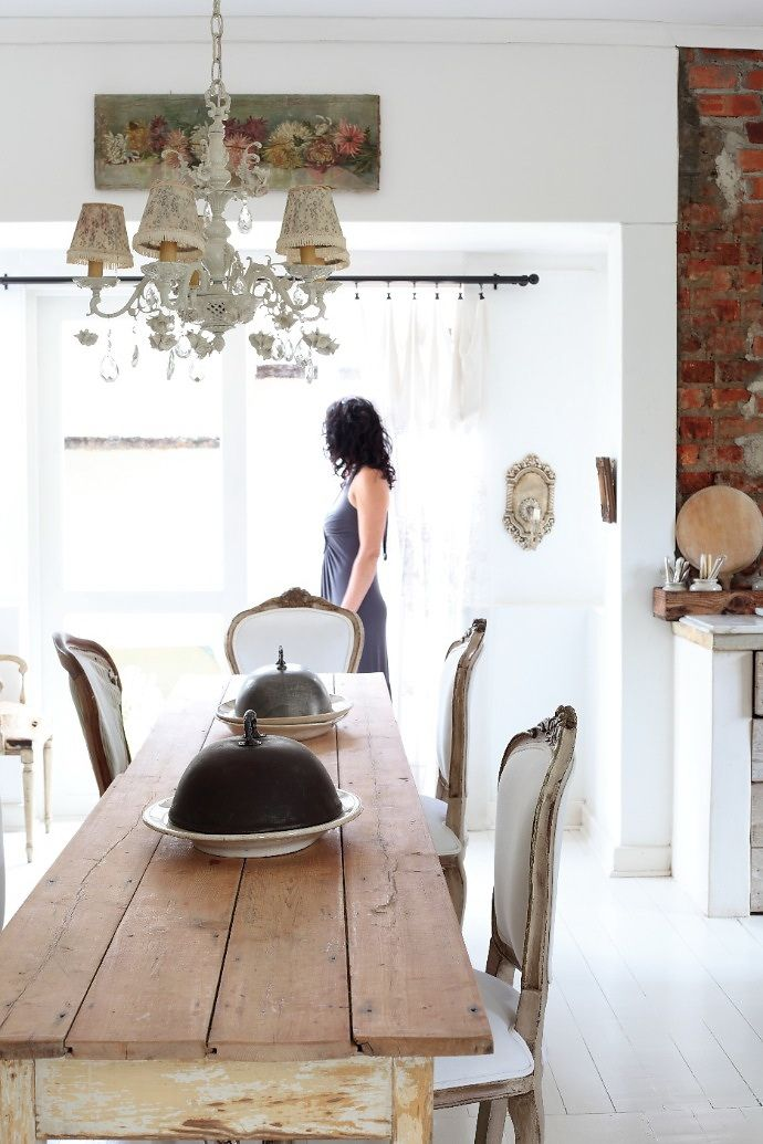 Need these chairs! Love the formal chairs with the rustic table and floral yard-long painting. Great exposed brick and white walls.