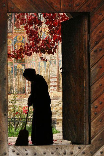 A nun tidies up inside the Moldovița Monastery Cosmin Danila (Brașov, Romania) Photographed September 2006, Bucovina,