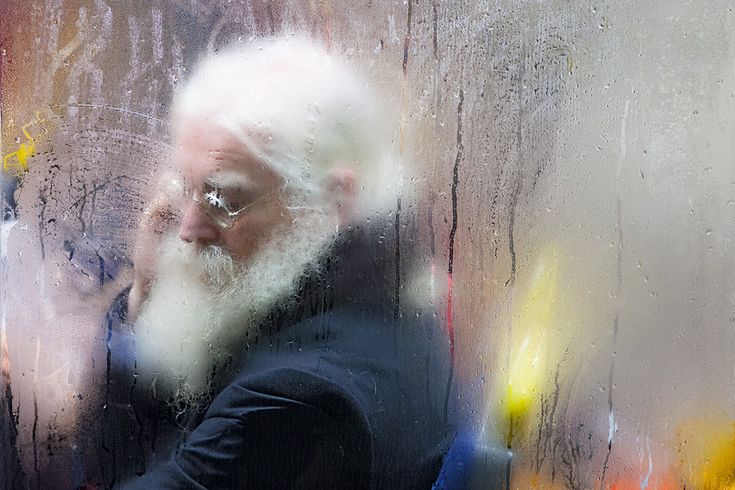 Portrait of an old man with a long white beard, captured as he travels on the night bus. Image by Nick Turpin for a new book titled On The Night bus by Hoxton Mini Press