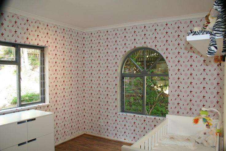 """The white and reds of Fable's """"Big Top Red"""" create a soft pink undertone, perfect for a young girls room."""