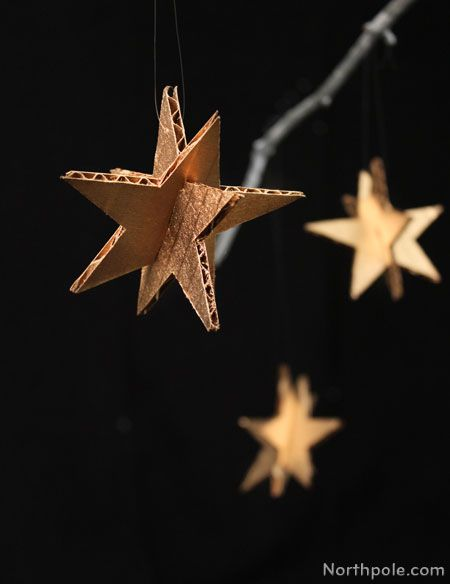 Easy DIY cardboard star ornaments. Paint them silver or gold!
