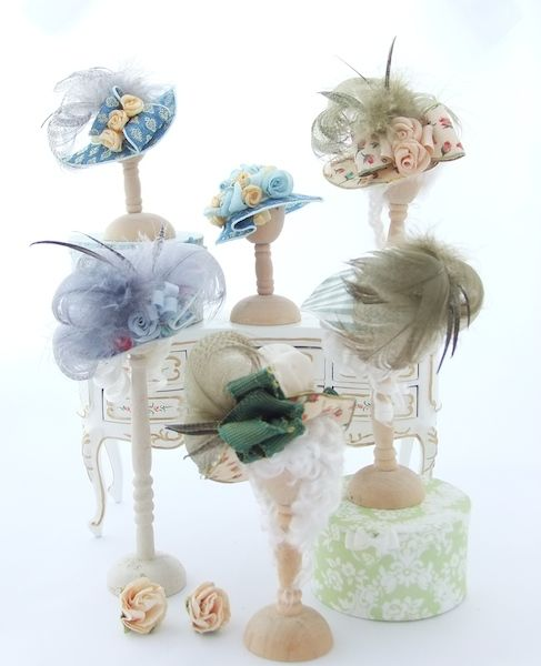 A few patterned hats in silk and cotton all lavish picture hats with feathers bows and flowers