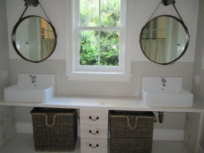 The bath that connects the children's room and the nursery has inexpensive materials mixed with Ikea sinks and pull out baskets for laundry. This way of using space creatively and functionally is what makes a good showhouse room really stand out.