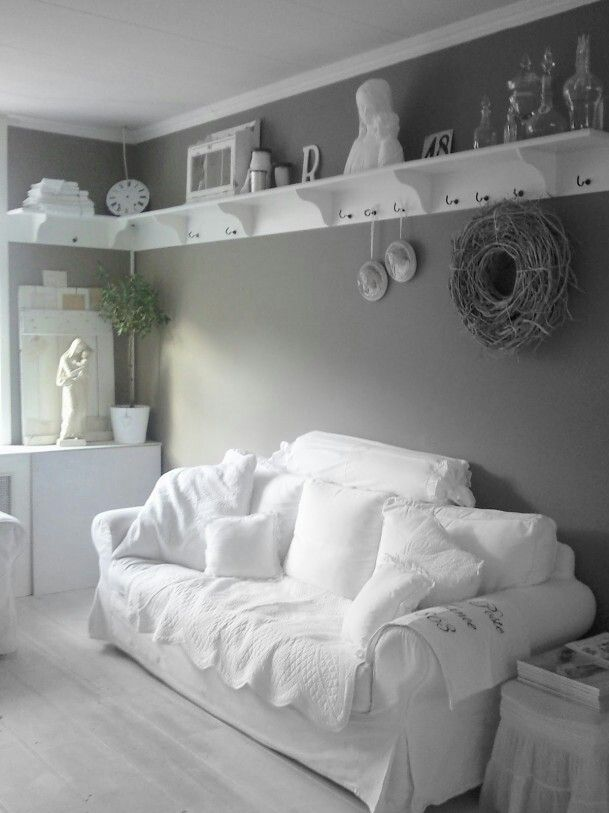 Cozy shabby chic style with shelves that wrap around the top of the wall!