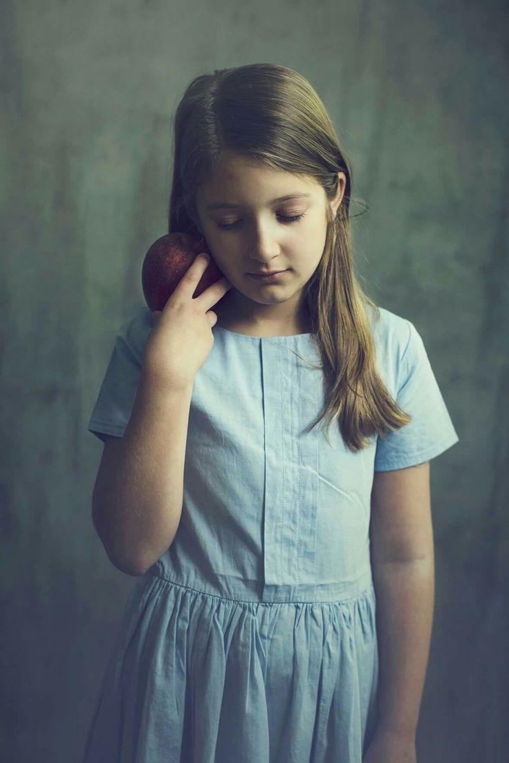 The love for apple ❤  #fineart #photography #photo #model #kid #kids #apple #bluedress #soft   Photo by @karinbakkerfotografie  Model : Iris Dress: wheat  Backdrop: Savage Muslin Milano