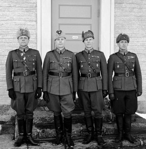 General Erik Heinrichs (1891-1983) at home with his brothers Olof (1891-1983), Gunnar (1893-1953) and Bertil (1897-1992). All three of them are Colonels. Kulosaari, Helsinki. 8 March 1943.