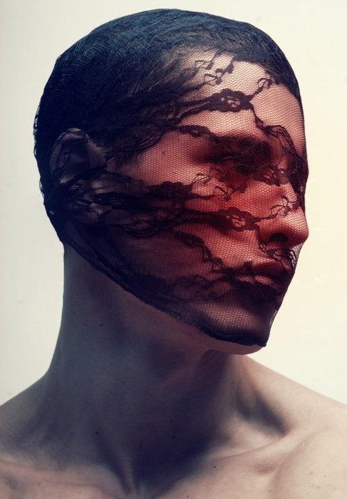 Black Lace sheild over mans face