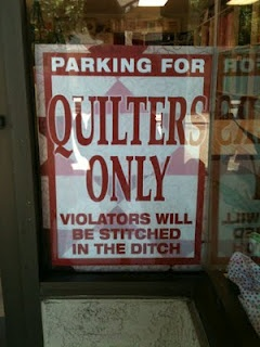 """Store with Best Sense of Humor"",  Parking for Quilters Only sign."