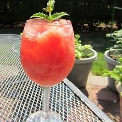 Watermelon puree is frozen, then blended with vodka, melon liqueur, lemon juice and simple syrup.