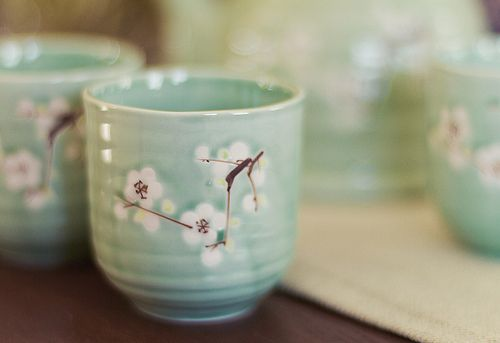 Love the little white cherry blossoms on these tea cups