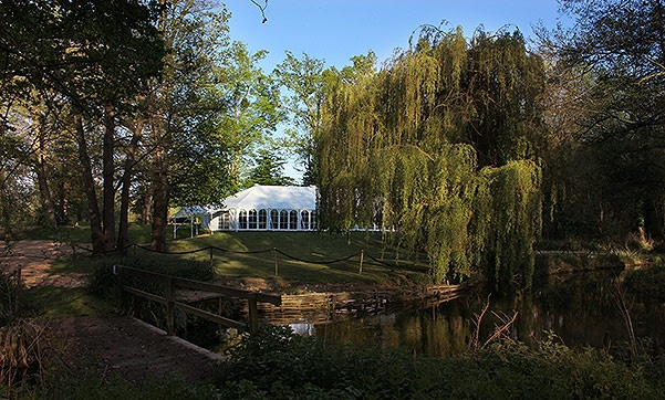 Timsbury Manor near Winchester in Hampshire provides a beautiful glamping and wedding venue.  Marquee courtesy of Southern Marquees Ltd
