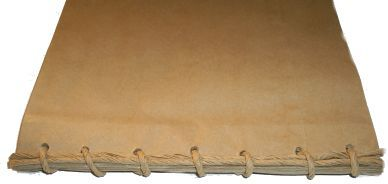 This brown paper bag scrapbook album uses non gusseted lunch bags which can be found in supermarkets in the food packaging sections.  Brown paper bags without gussets are quite lightweight which means your album will not have the same Bulk as a traditional gusseted brown paper bag album.