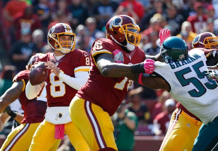 Eagles vs. Redskins:     October 16, 2016   -  27-20, Redskins  -     Washington Redskins quarterback Kirk Cousins (8) looks for a receiver as he is pressured in the first half of an NFL football game against the Philadelphia Eagles, Sunday, Oct. 16, 2016, in Landover, Md.
