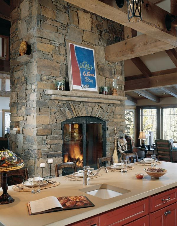 Double-Sided Stone Fireplace with Stone Mantel. Central fireplace with kitchen, dining and great room surrounding it. Perfection!
