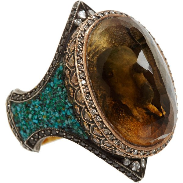 Sevan Bicakci 24k yellow gold, 18k rose gold and oxidized sterling silver ring features an intaglio-carved elephant encased within a faceted citrine stone