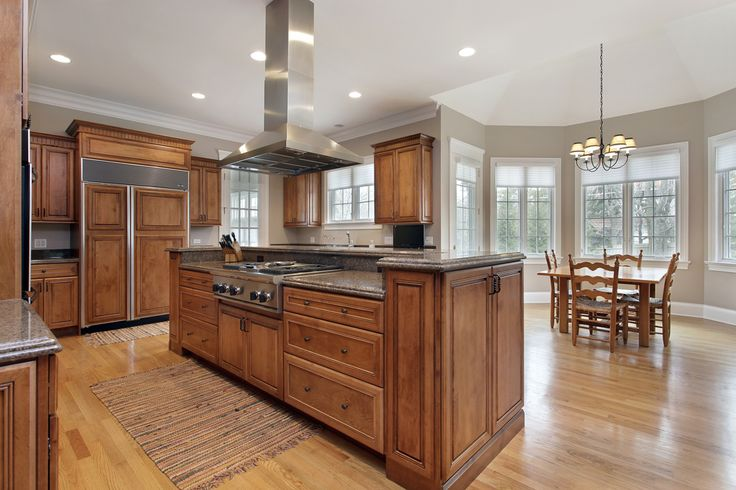 Wood Island with Stove, Refrigerator with Panels that Match Cabinetry, Breakfast Nook, Lots of Windows for Natural Lighting.
