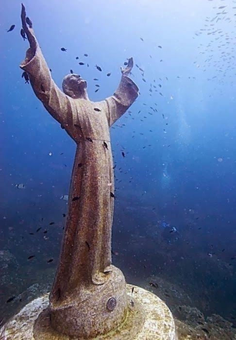 The Christ of the Abyss is a bronze statue placed in 1954 on the bottom of the bay of San Fruttuoso, between Camogli and Portofino inside Portofino's Protected Natural Marine Area, 15 meters deep. Description from misakipureblood.blogspot.com. I searched for this on bing.com/images