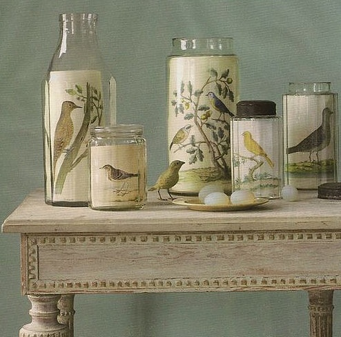 Place vintage botanicals or bird drawings inside interesting  glass containers.  Scatter coordinating items, such as eggs,  feathers or nests around them and voila, an interesting display! - Brabourne Farm