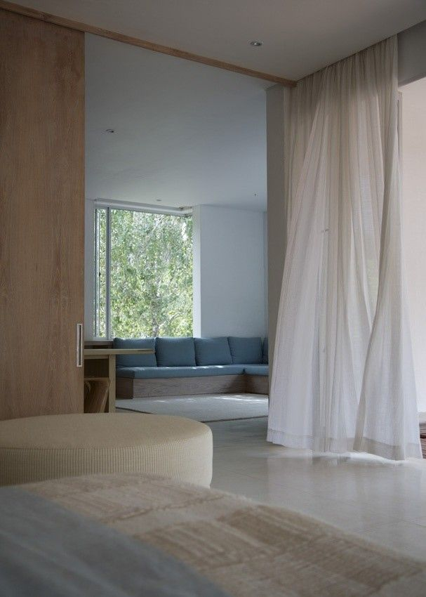 Full height sheer curtains in house in Cape Town