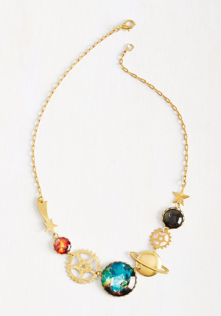 2001: A Space Prodigy Necklace. Display your physics knowledge in an unexpectedly stylish way by sporting this golden necklace at your space exploration lecture. #gold #modcloth