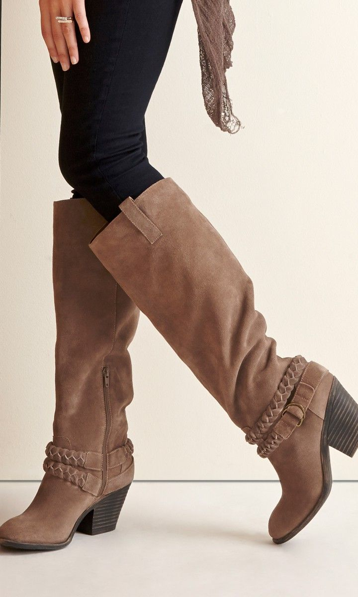Genuine suede knee-high boots with a stacked heel, braided strap detail, buckles and a rounded toe.