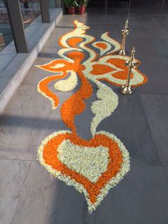 "Robin is currently in India! Here's what she wrote to us; ""We received a warm welcome from our agents in India today. This is a traditional rangoli made of margins petals. These beautiful designs originated from days when scattering rice powder outside a dwelling attracted insects and kept them out of the house. What a long way they've come."" #TravelwithRobin #India"