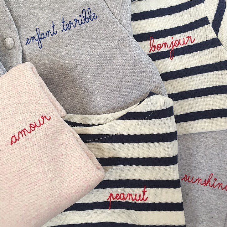 New arrivals from Parisian brand @maisonlabiche - luxe wardrobe staples (sweats, Breton tops and baby bodysuits, jersey baseball jacket and tee) with embroidered motifs: enfant terrible, amour, peanut, bonjour, sunshine and Cookie Monster. Online now & tres bon!