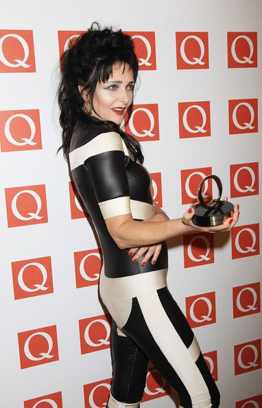 Siouxsie Sioux Photos Photos - Siouxsie Sioux Winner of Oustanding Contribution to Music with Pam Hogg at the The Q Awards at The Grosvenor House Hotel on October 24, 2011 in London, England. - The Q Awards - Media Room