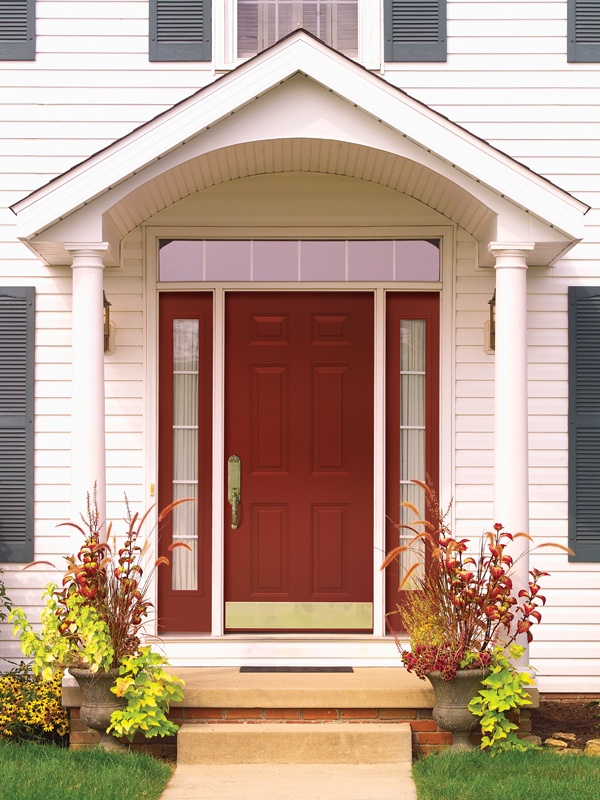 A Bold Red Provia Steel Entry Door With Sidelights