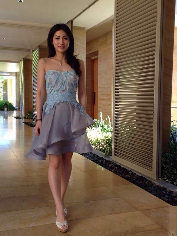Corynna in our pretty baby blue sheer summer dress.