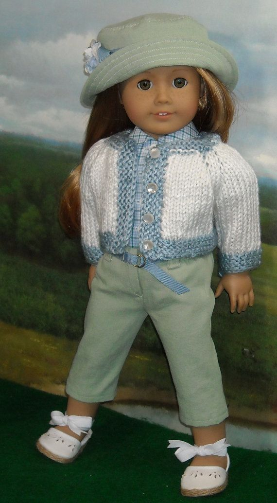 Blue Check Blouse, Green Capris and Hat, with Sweater for Contemporary 18 inch Girls. This set includes the bucket hat, two tone sweater, cotton blouse and capris with belt. The acrylic sweater, knit by Kathy, closes in front with 4 buttons. The little hat has a brim that can be worn multiple ways, a blue ribbon band, and a little flower for extra perkiness! From SugarloafDollClothes.