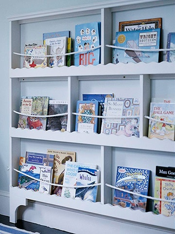 Bookcase storage. Nautical bookcase displays  books and magazines behind decorative trim and rope. The theme makes it especially fun in kid´s room. Add strands of flexible rope to a plate rack. Tuck the rack behind the door. @mrslono when do we do this?!  :)