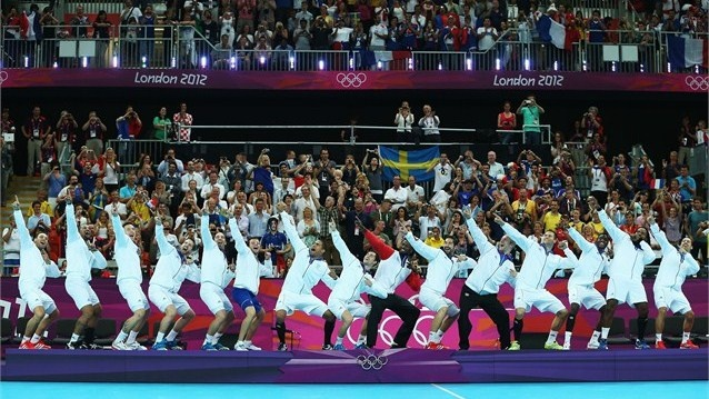 France celebrate on the podium after winning the gold medal against Sweden during the Men's Handball Gold Medal Match on Day 16