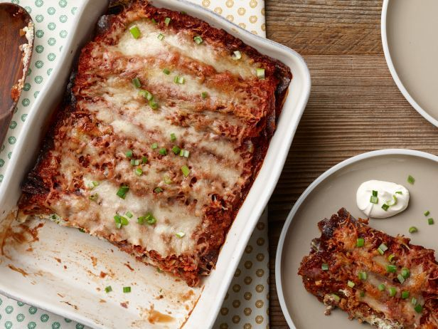 Bobby Flay puts a spin on Goat Cheese Enchiladas by swapping the usual flour or white corn tortillas for blue corn torillas.