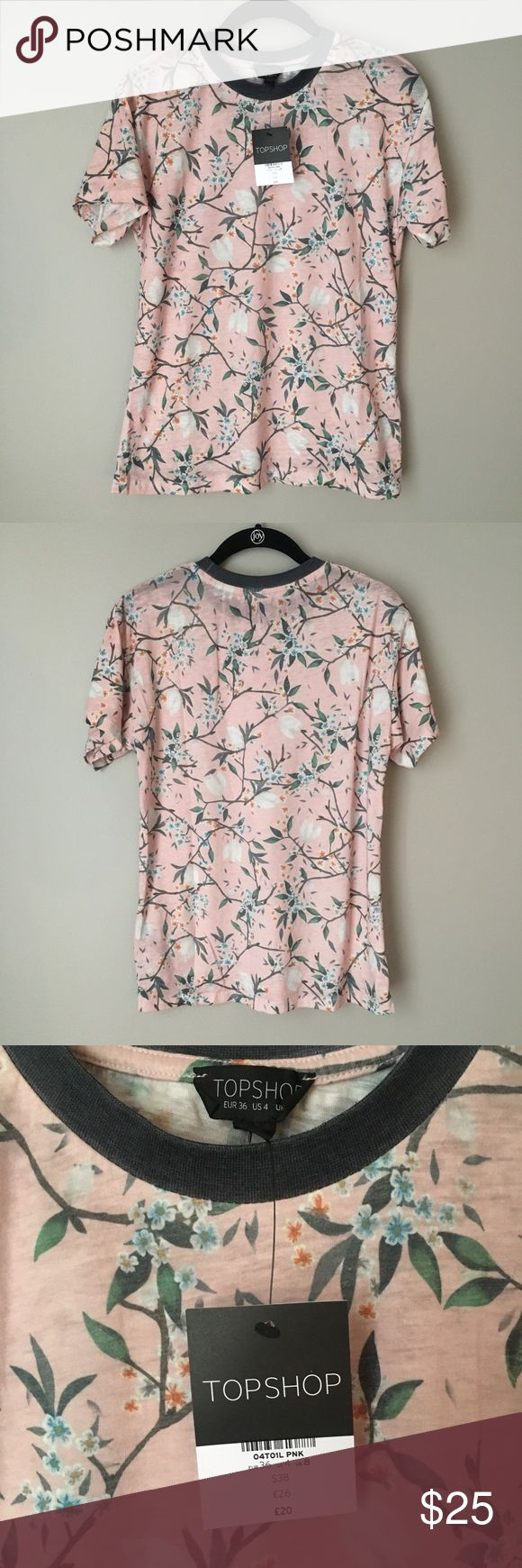 """NWT! Topshop """"Tokyo Blossom"""" Pink Floral Tee SPRING IS IN THE AIR! Ok, maybe that's just wishful thinking, but it'll be here before you know it! Get ready for the season in this pretty pink floral """"Tokyo Blossom"""" tee by topshop. Brand new with tags, retails for $38!  Make an offer! Topshop Tops Tees - Short Sleeve"""